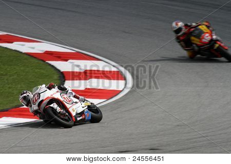 SEPANG, MALAYSIA - OCTOBER 22: Moto2 rider Yuki Takahashi competes with another rider at qualifying race of the Shell Advance Malaysian Motorcycle GP 2011 on October 22, 2011 at Sepang, Malaysia.