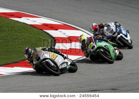 SEPANG, MALAYSIA - OCTOBER 22: Moto2 rider Thomas Luthi (12) competes with other riders at qualifying race of the Shell Advance Malaysian Motorcycle GP 2011 on October 22, 2011 at Sepang, Malaysia.