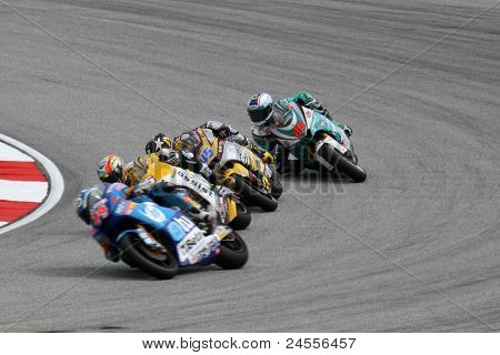 SEPANG, MALAYSIA - OCTOBER 22: Moto2 riders take turn 1 during the qualifying session of the Shell Advance Malaysian Motorcycle GP 2011 on October 22, 2011 at Sepang, Malaysia.