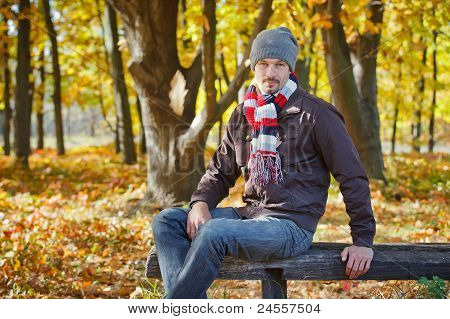 Man in autumn park