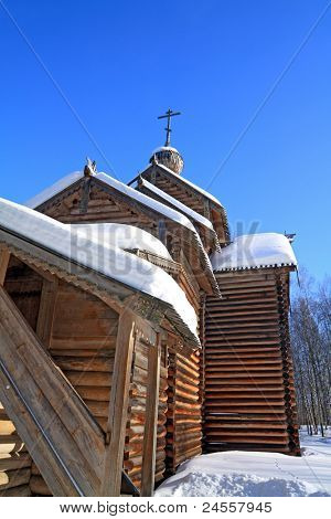 wooden chapel on blue background