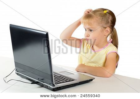 Little girl playing on the computer