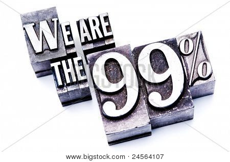 "The phrase ""We are the 99%"" in letterpress type. Cross processed, narrow focus."