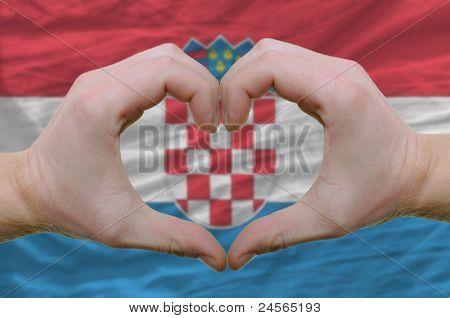 Heart And Love Gesture Showed By Hands Over Flag Of Croatia Background