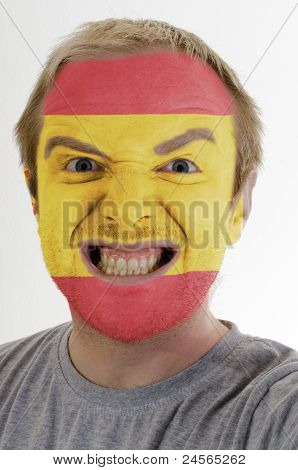 Face Of Crazy Angry Man Painted In Colors Of Spain Flag