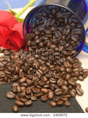 Coffee Beans Spilling On Various Colored Tablecloths