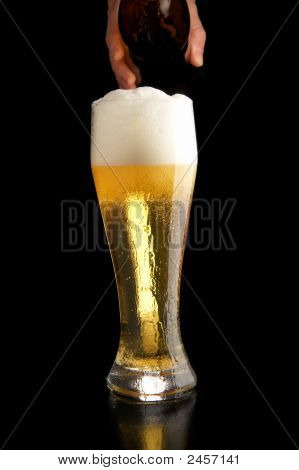 Pouring Beer Into Glass