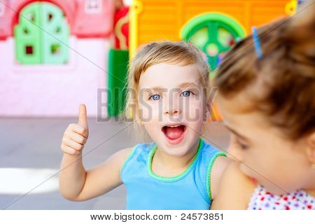 children happy little sister girls with ok hand gesture