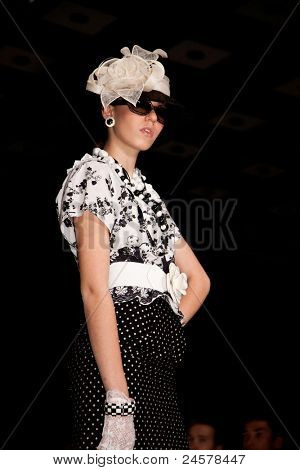 MOSCOW - OCTOBER 21: A model displays a creation by Russian designer Slava Zaitsev during Mercedes-Benz Fashion Week Russia on October 21, 2011 in Moscow, Russia.