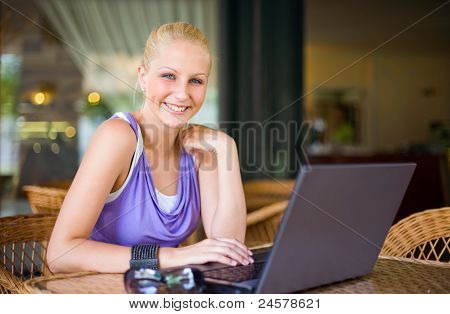 Beautiful Young Blond Having Fun With Laptop.