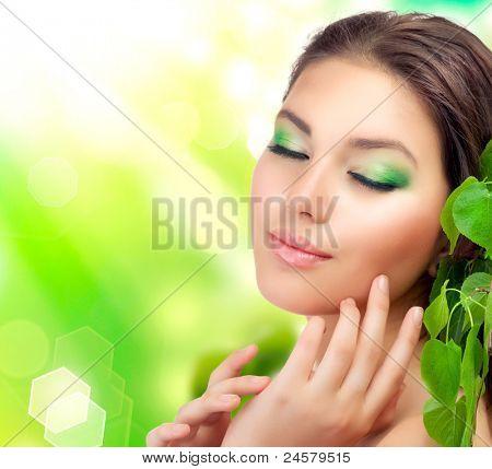 Beautiful Girl outdoors applying the natural cosmetics. Perfect fresh skin