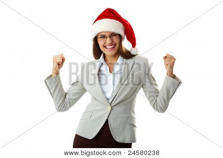 Portrait of ecstatic businesswoman in Santa cap showing her triumph