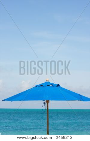 Blue Sea Sky And Umbrella