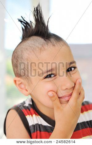 Cute little boy with funny hair and grimace