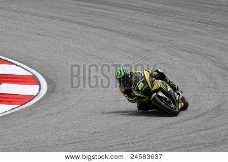 SEPANG, MALAYSIA - OCTOBER 22: MotoGP rider Cal Crutchlow competes at the qualifying session of the Shell Advance Malaysian Motorcycle Grand Prix 2011 on October 22, 2011 at Sepang, Malaysia.