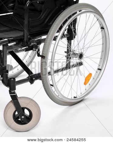 Close up of a invalid chair wheels.