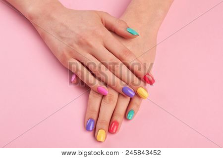 poster of Female Hands With Colorful Polish Nails. Woman Well-groomed Hands With Multicolor Nails On Salon Tab