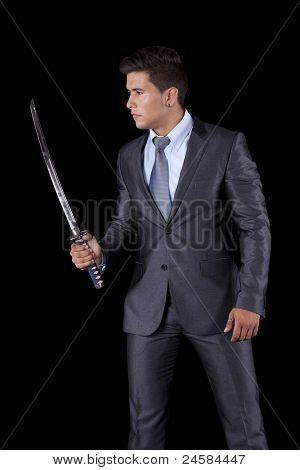 Powerful businessman holding a ninja sword (isolated on white)