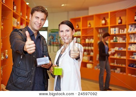 Customer And Pharmacist Holding Thumbs Up