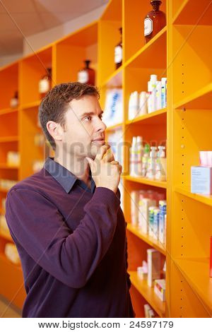 Man Buying Medicine In Pharmacy