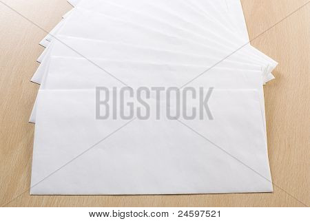 Plain Envelopes On A Table.