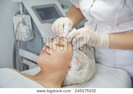 poster of Face Lifting. Young Woman Getting Facial Massage In The Cosmetology Salon. Procedure Of Facial Massa