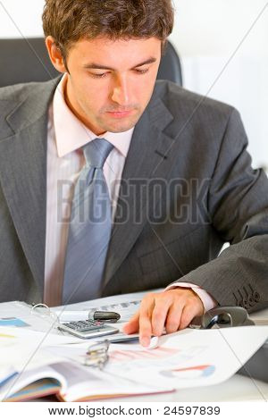 Serious Modern Businessman Working With Documents
