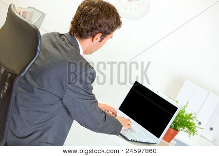 Modern Businessman Working On Laptop