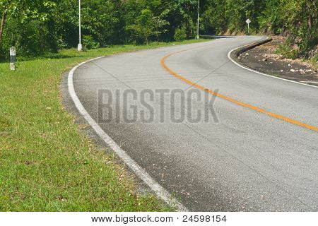 Road Curves Up To Mountain