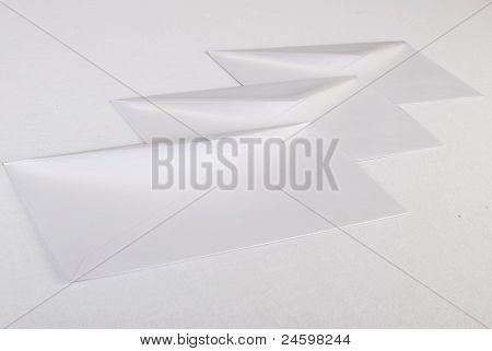 Close Up Of White Envelopes On White Background.