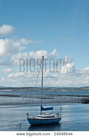 Sailing Boat In Mooring At Low Tide