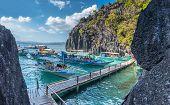 Palawan, Philippines - March 25, 2018:  tourists boats at Barracuda Lake lagoon at Coron Island, Pal poster