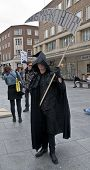 The Grim Reaper prowls the streets of Exeter during the Protest against NHS reforms