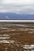Low Water Level February Landscape At Lake Kerkini, Greece With Car Traces And Smoke, Low Clouds And poster