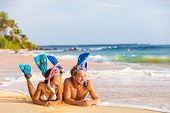 Luxury travel leisure activity watersport fun people relaxing after snorkel swim. Beach couple on su poster