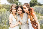Three Beautiful Cheerful Hippie Girls, Best Friends, Laughing, Posing For The Camera, Trendy Hairsty poster