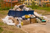 Crowded Dumpster In The Area Of Construction Of A New Urban Residential Area. poster