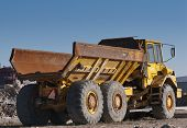 stock photo of dump-truck  - Dump track on a construction site in a summer day - JPG