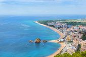 Coast, Rock Sa Palomera And Architecture Of Spanish Beach Resort Blanes In Summertime. Sunny Panoram poster