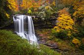 stock photo of appalachian  - Dry Falls Autumn Waterfalls Highlands NC Forest Fall Foliage in Cullasaja Gorge Blue Ridge Mountains - JPG