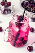 Cold Drink With Cherry In Jars On White Wooden Background Cold Detox Infused Water Summer Drink Vert poster