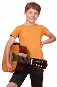 pic of musical instrument string  - Portrait of a young boy holding a classical guitar - JPG