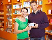 Couple Buying Medicine In Pharmacy