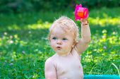 Toddler Baby Girl With Blue Eyes  Having Fun With Water poster