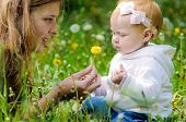 picture of defloration  - Young mother with little baby at the park - JPG