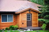 Front of rental cabin with cedar plank siding poster