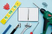 Set Of Construction Tools On Blue Flat Lay As Wrench, Hammer, Pliers, Socket Wrench, Spanner, Water  poster
