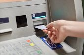 Someone Takes Off Money From Outdoor Bank Terminal, Inserts Plastic Credit Card In Atm Machine, Goin poster