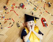 Little Cute Preschooler Boy Among Toys Lego At Home In Graduate Hat Smiling Posing Emotional, Lifest poster