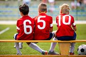 Постер, плакат: Football Soccer Children Team Kids Substitute Players Sitting On A Bench Football Sports Tournamen